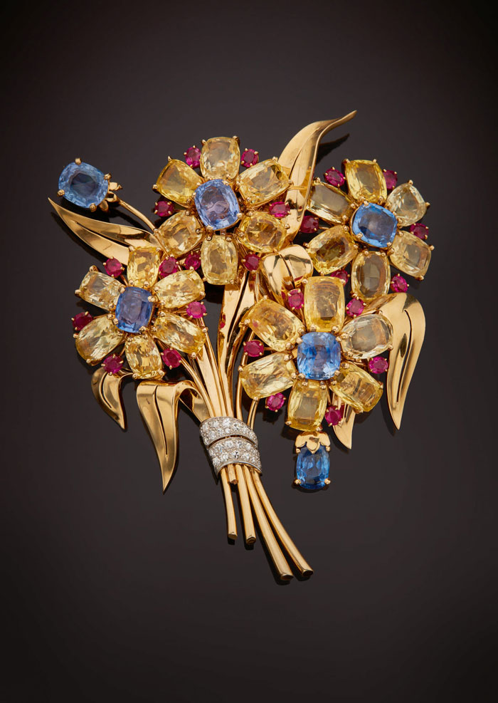 Gold clip brooch with rubies and sapphires