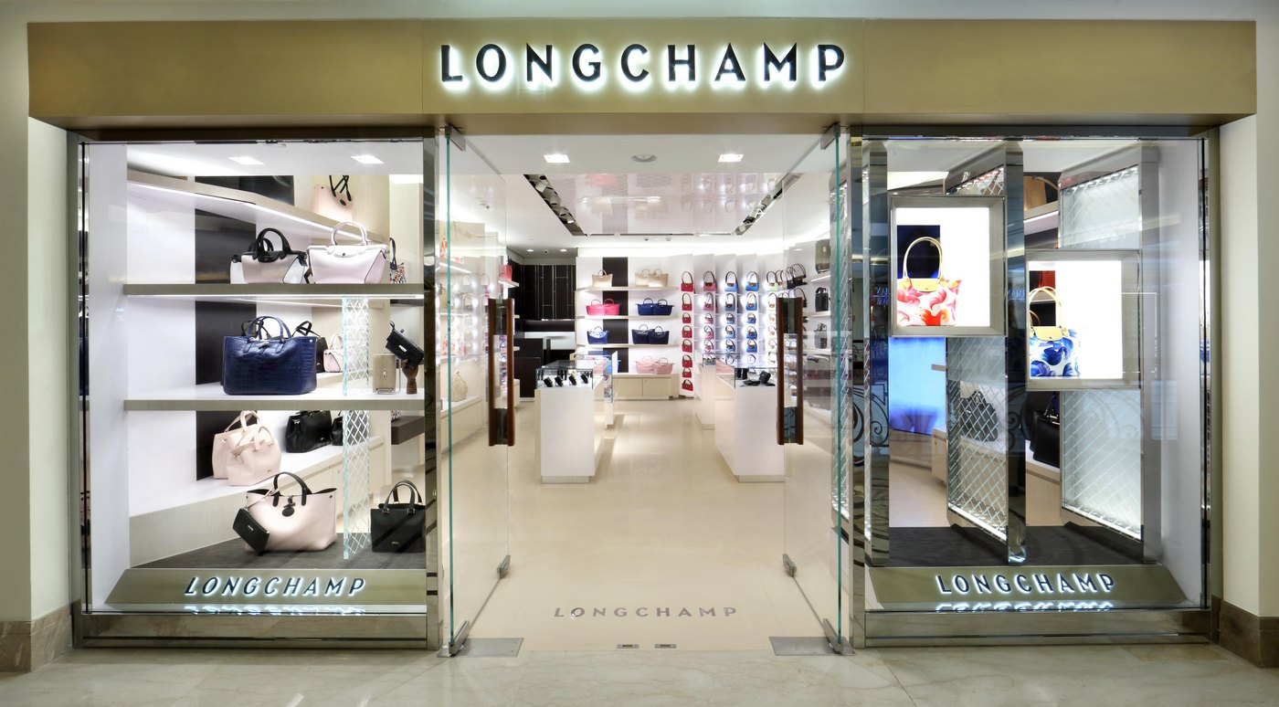 Longchamp celebrates the opening of its first boutique